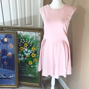 Pale pink dress with sheer cutout detail in back